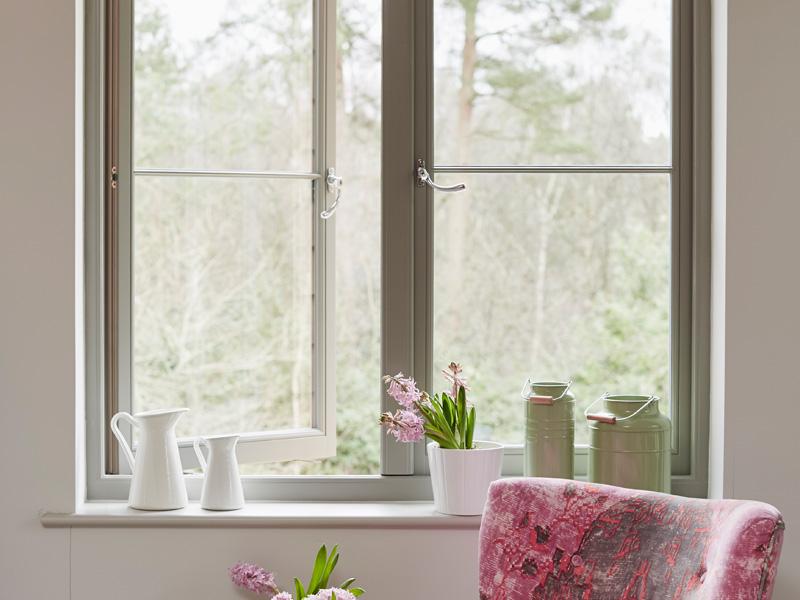 Green casement windows open