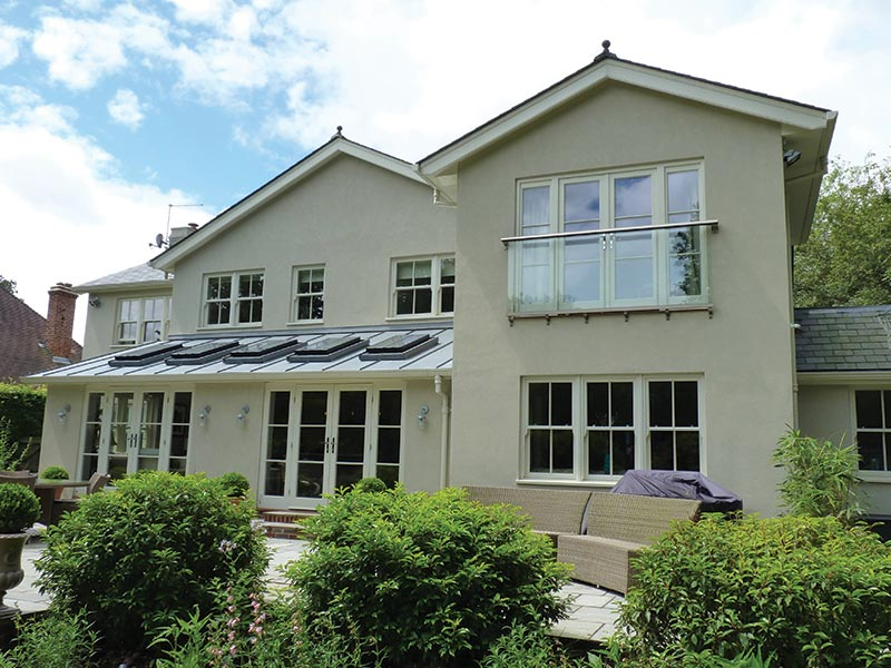 rear elevation of house with sash windows with bars