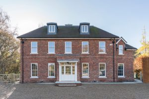 brick house with sash windows and large bespoke front door