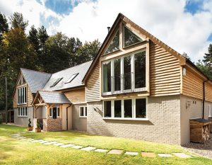 timber clad building with feature windows