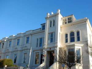 luxury property with curved sash windows