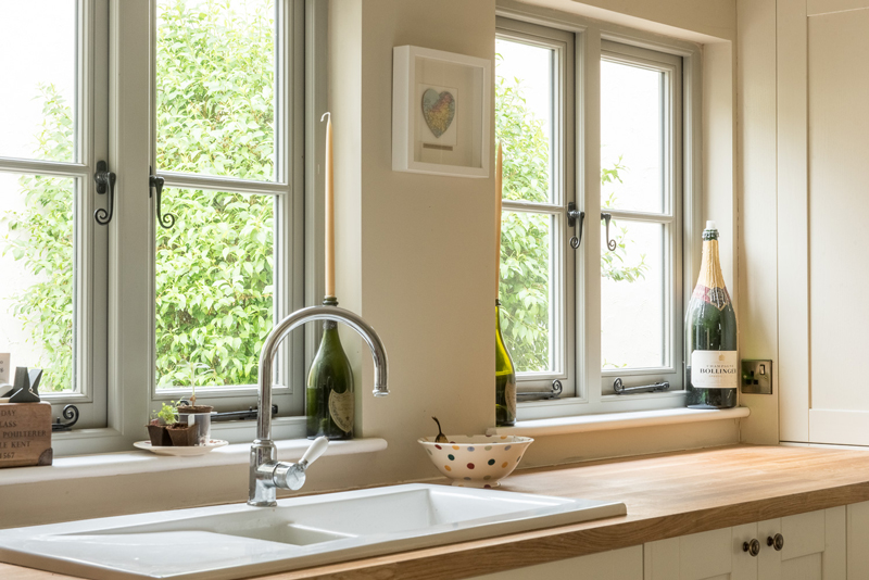kitchen with flush casement windows monkey tail handle