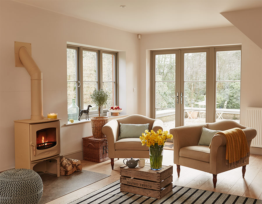 Cosy room with log burner french doors and casement windows
