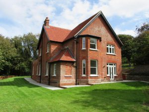 Large detached house with sash windows and french doors