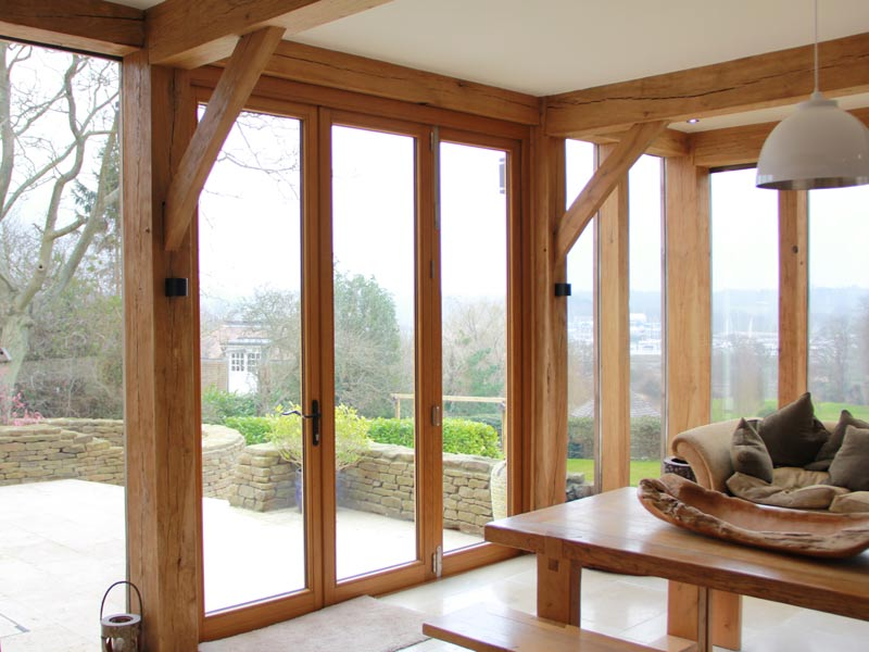 Stained bi-fold timber doors