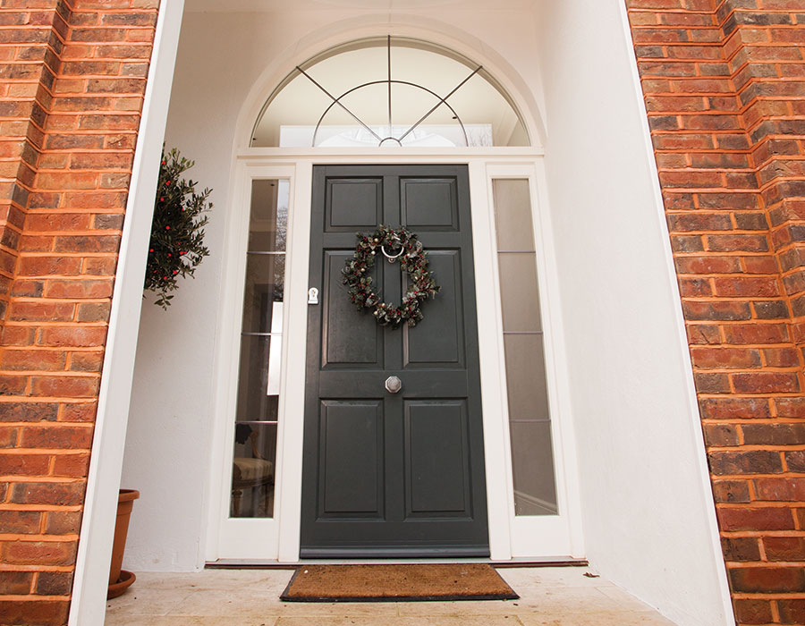 Bereco bespoke front door in timber with sidelights and fanlight