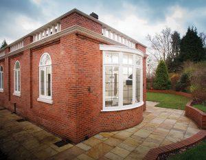 brick house with bay window leaded glass
