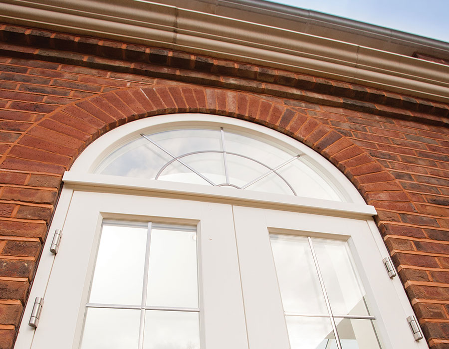 Laurel House with Bereco timber flush french doors with curved fanlight