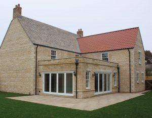 stone property with bi-fold doors