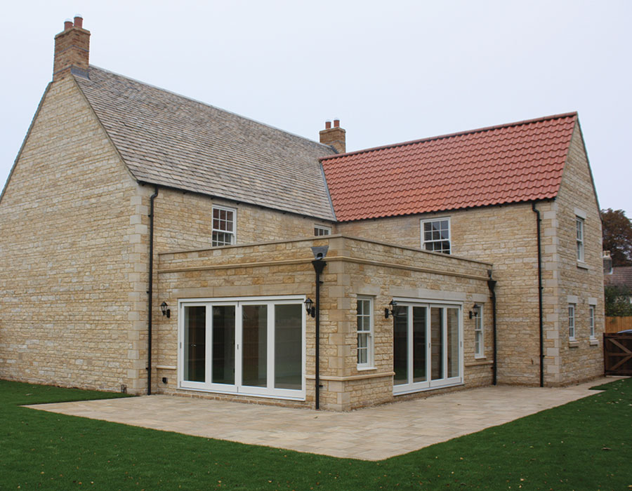 stone property with bi-fold doors