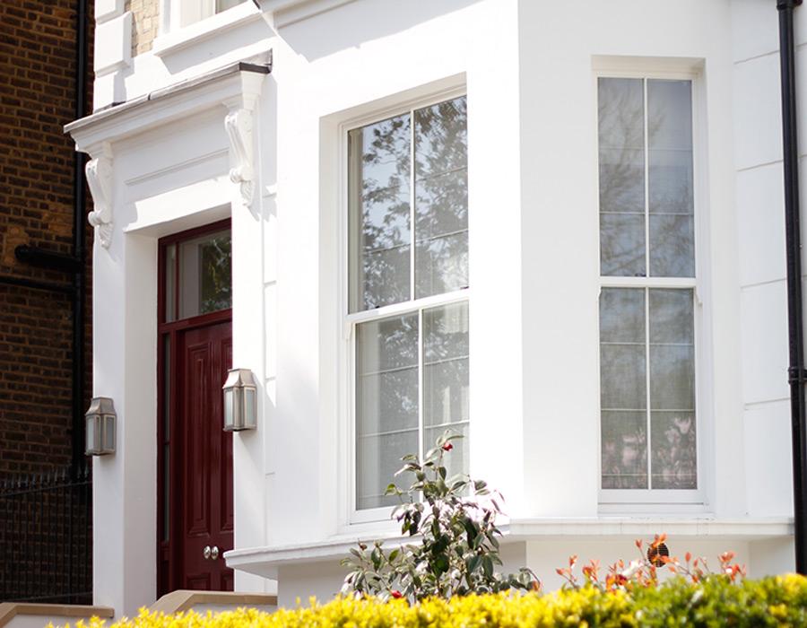White tall Sliding Sash windows