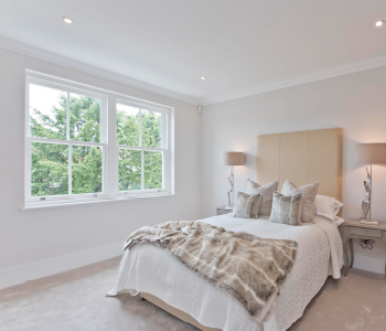 Light bedroom with sliding sash windows