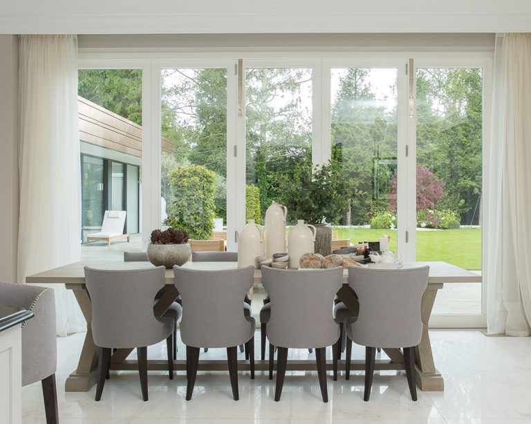 dining room with white folding doors