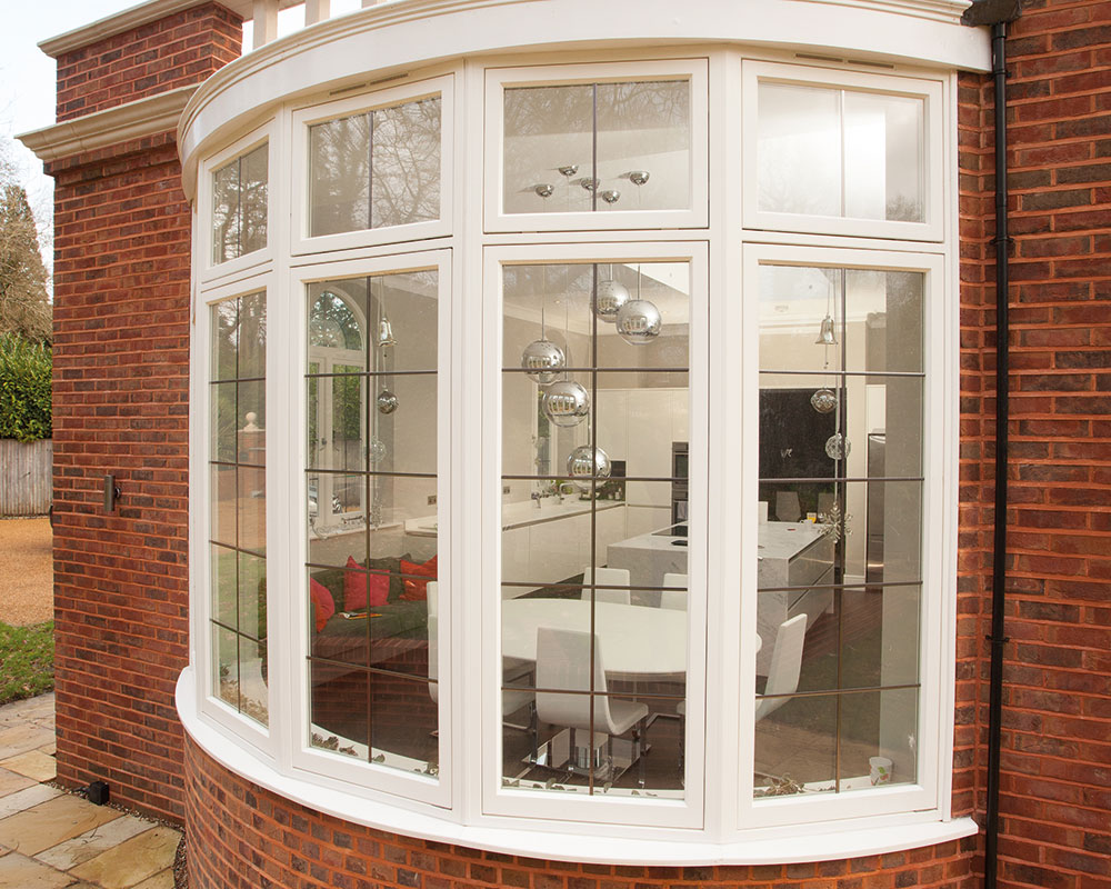 Curved casement window with leaded glass