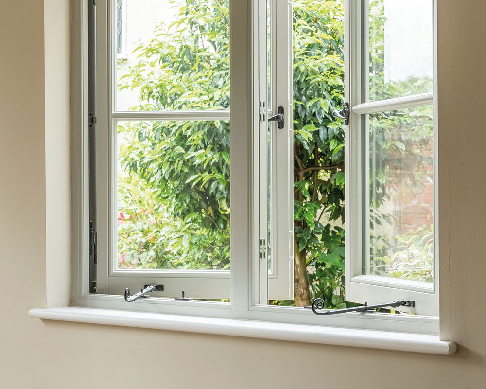 casement windows open with monkey tail stay and handles