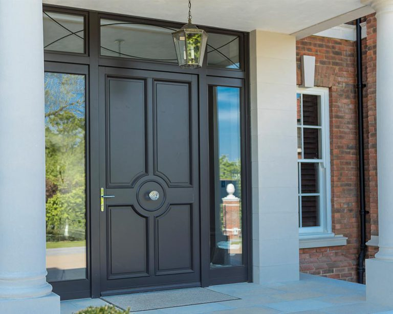 Black bespoke front door with side panels