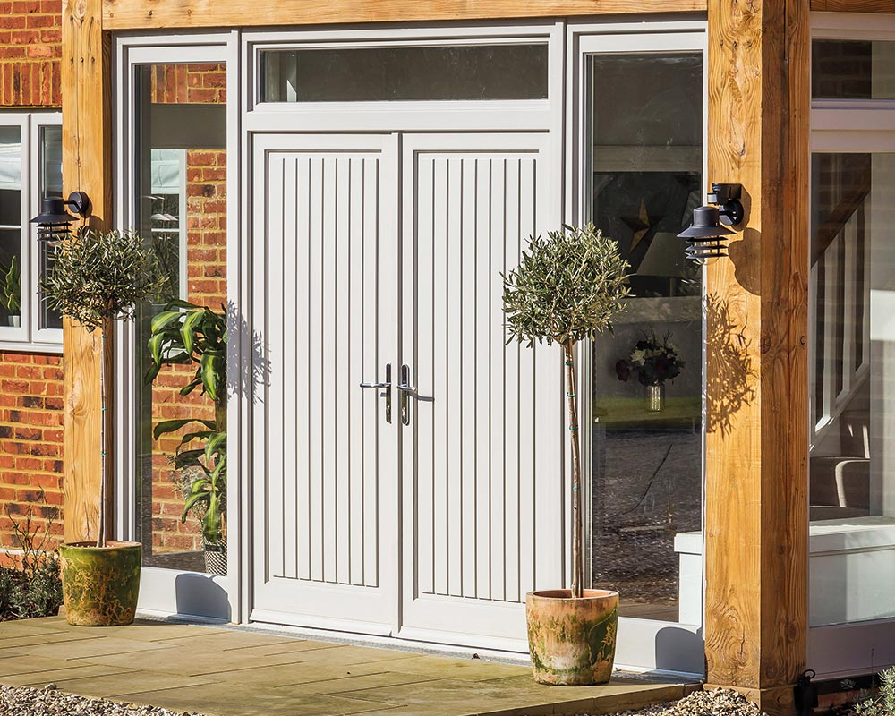 double set of solid doors with sidelights