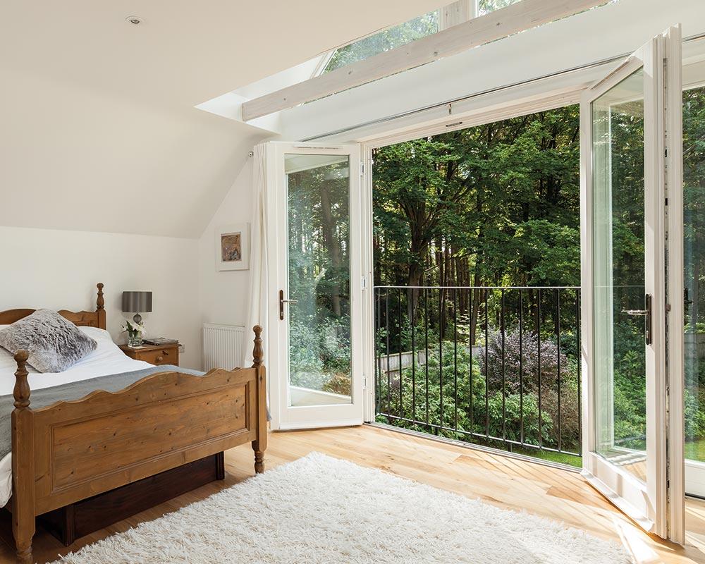 modern bedroom with french doors open