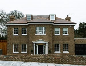 Brick house with bespoke sash windows and black front door