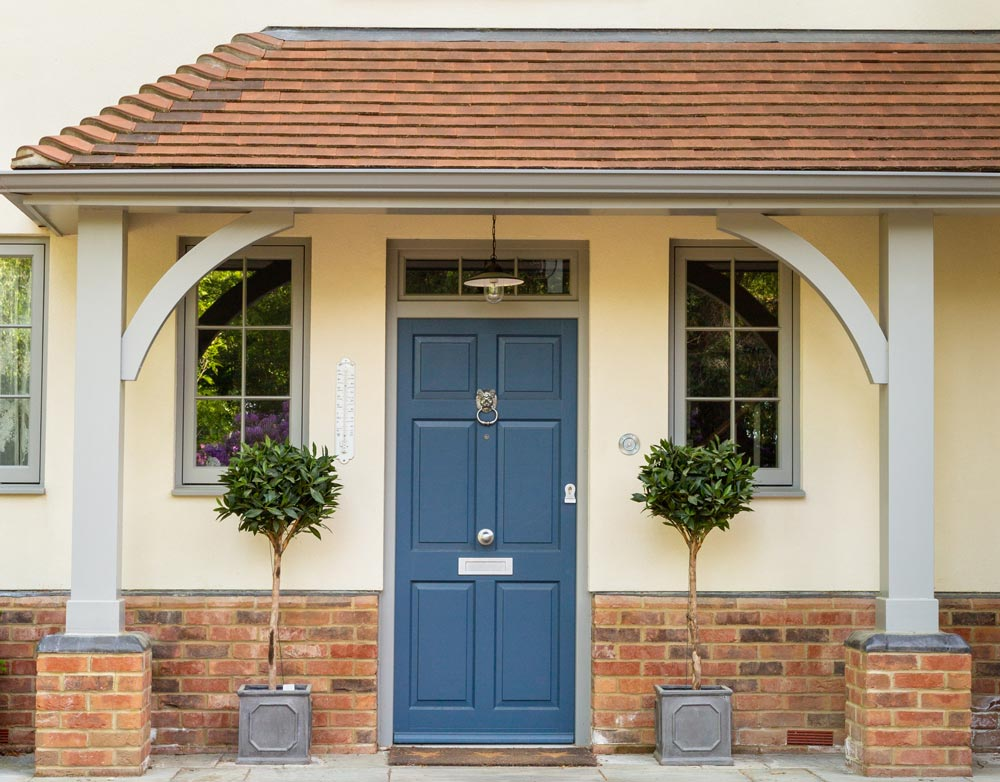Blue front door with grey frame
