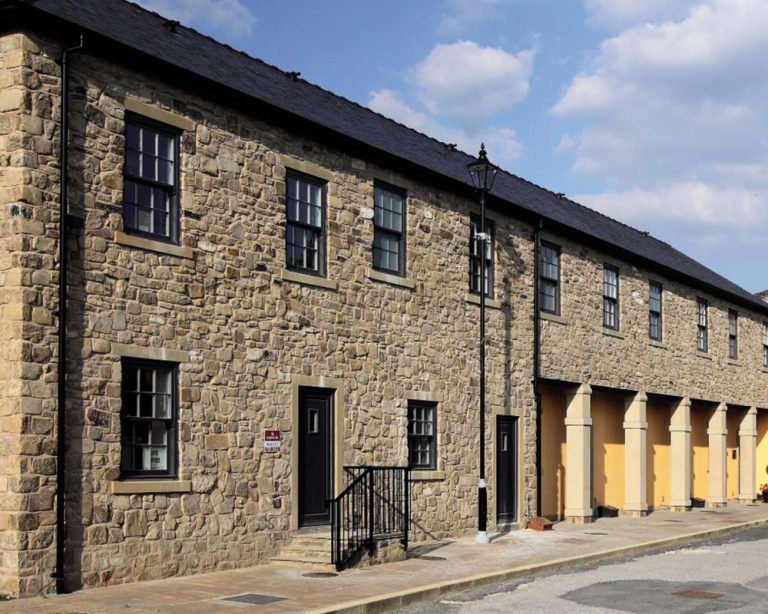 dark sliding sash windows row of houses