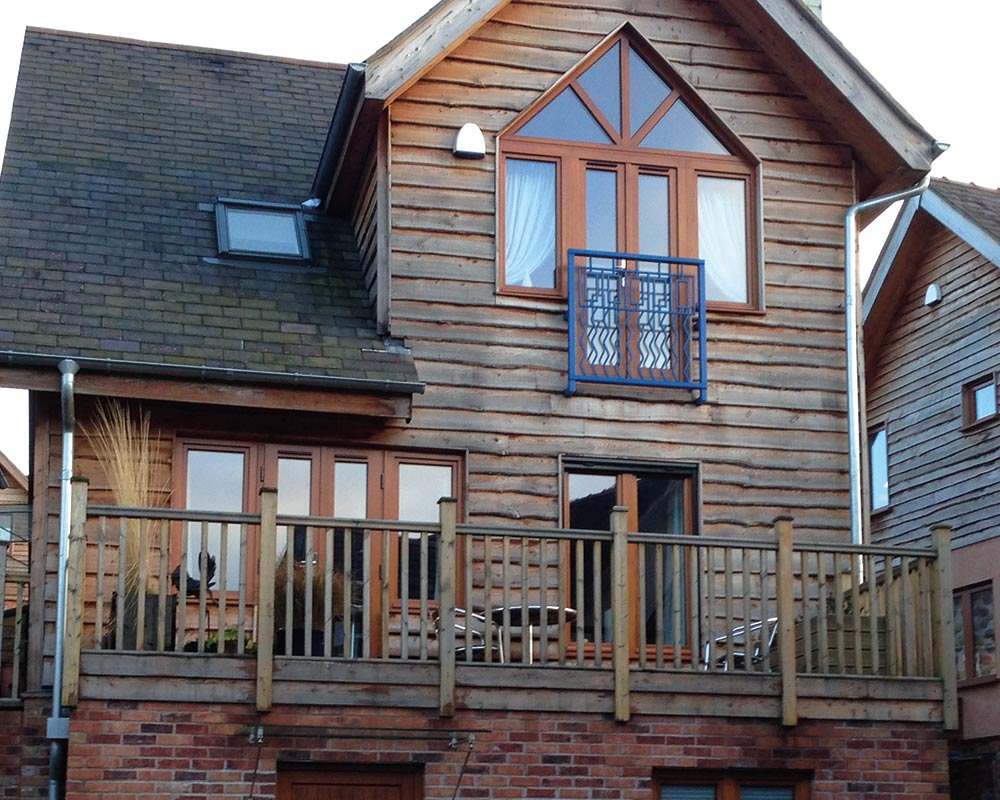 stained tilt and turn windows with bespoke triangle